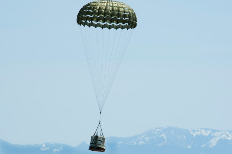 A Container Delivery System bundle lands on the drop zone known as Charging Charlie May 29, 2019, at Malmstrom Air Force Base, Mont.