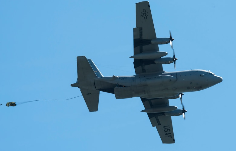A C-130 Hercules transport aircraft from the Montana Air National Guard 120th Airlift Wing drops a Heavy Equipment load on the flight line May 29, 2019, at Malmstrom Air Force Base, Mont.