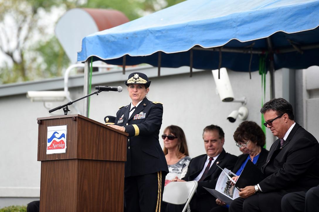 Brig. Gen. Kris Belanger, Commanding General, 85th U.S. Army Reserve Support Command, gives remarks, as the keynote speaker, during the Village of Norridge Memorial Day commemoration, Mar. 26, 2019.