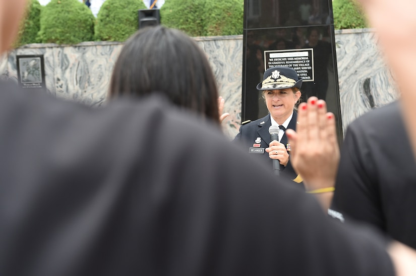 Brig. Gen. Kris Belanger, Commanding General, 85th U.S. Army Reserve Support Command, swears in new Army recruits during the Village of Norridge Memorial Day commemoration, Mar. 26, 2019.