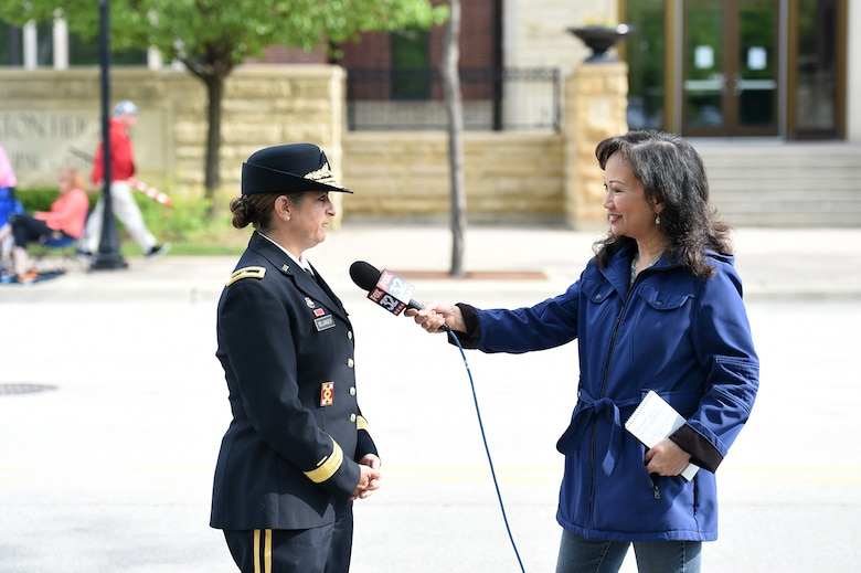 Brig. Gen. Kris Belanger, right, Commanding General, 85th U.S. Army Reserve Support Command, speaks on Memorial Day during an interview with Fox 32 News during the Village of Arlington Heights Memorial Day commemoration, Mar. 27, 2019.