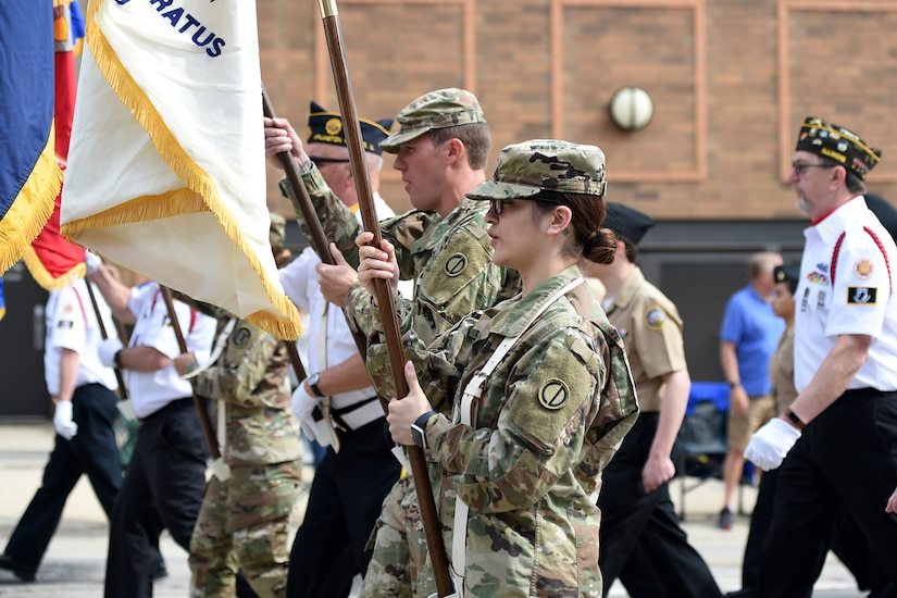 Sgt. Andrew Raynor, left, and Sgt. Maribel Meraz, both assigned to the 85th U.S. Army Reserve Support Command, march in the Village of Arlington Heights Memorial Day parade, Mar. 27, 2019.