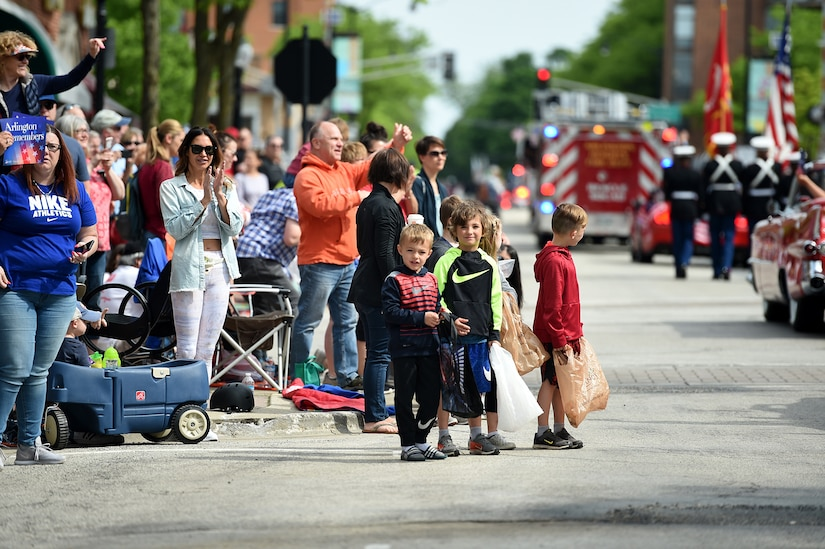 Children look on during the Village of Arlington Heights Memorial Day parade, Mar. 27, 2019.