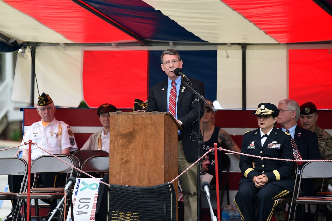 Mayor Thomas Hayes, Mayor of Arlington Heights and Army veteran, gives remarks during the Village of Arlington Heights Centennial Memorial Day commemoration, Mar. 27, 2019.