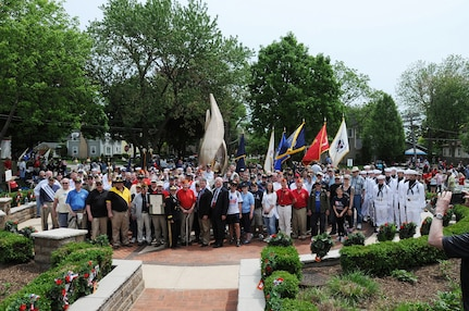 Service members, and veterans pause for a photo following the Village of Arlington Heights Centennial Memorial Day commemoration, Mar. 27, 2019.