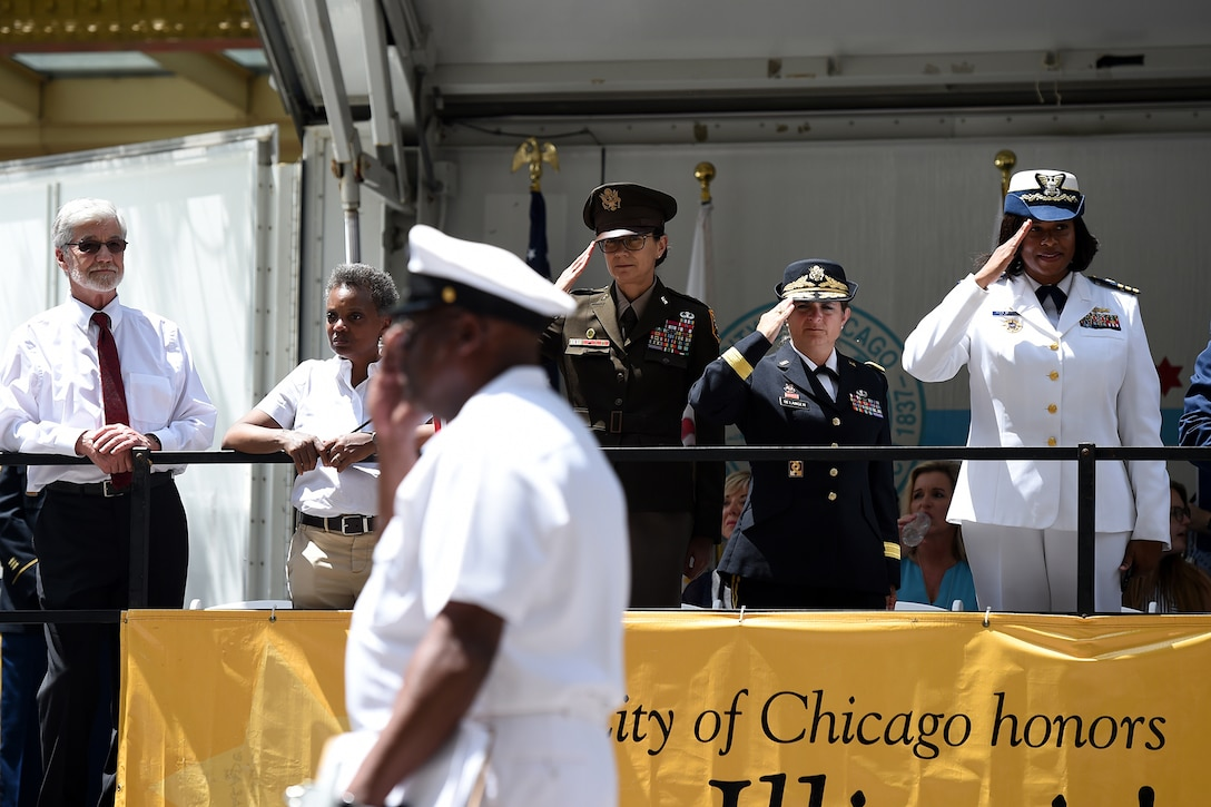 From left to right: Jim Frazier, Gold Star Family father of Staff Sgt. Jacob Frazier killed on March 29, 2003; Chicago Mayor Lori Lightfoot; Maj. Gen. Marion Garcia, Commanding General, 200th Military Police Command; Brig. Gen. Kris Belanger, Commanding General, 85th U.S. Army Reserve Support Command; and Commander Zeita Merchant, Commanding Officer, MSU Chicago, U.S. Coast Guard view the Chicago Memorial Day parade from the reviewing stand, Mar. 25, 2019.