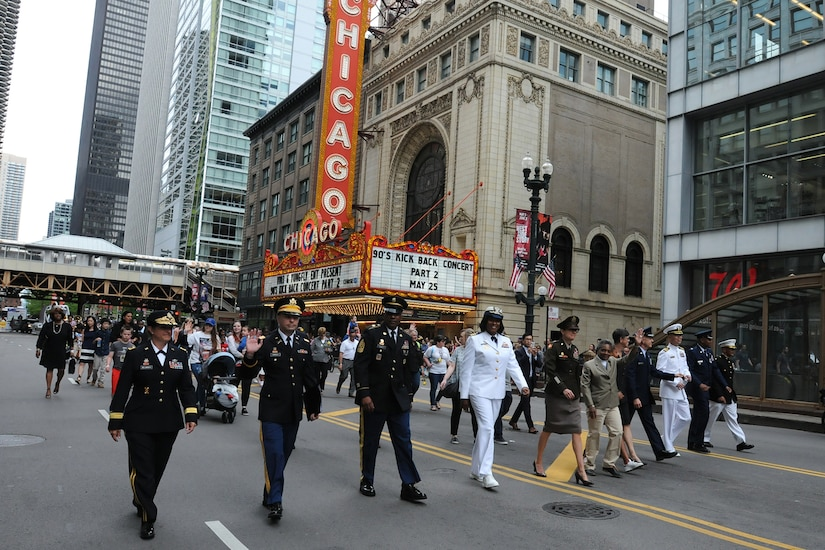 Brig. Gen. Kris Belanger, left, Commanding General, 85th U.S. Army Reserve Support Command; along with her Soldiers, military leaders and City of Chicago Mayor Lori Lightfoot step off in the Chicago Memorial Day parade, Mar. 25, 2019.