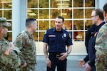 Sgt. 1st Class Nick Van Kirk, a logistics and decontamination non-commissioned officer with the 10th Civil Support Team and volunteer firefighter with South Bay Fire Department, talks with his two commanders before a ceremony Oct. 10, 2019, in Olympia, Washington.