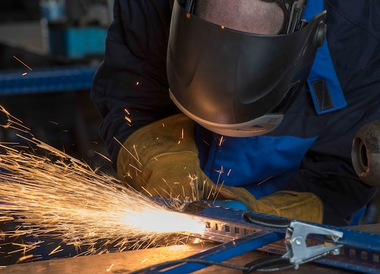 U.S. Air Force Staff Sgt. Jason Barnes, 39th Maintenance Squadron aircraft metals technology technician, uses a plasma cutter to cut excess material a railing, Oct. 25, 2019, at Incirlik Air Base, Turkey. Plasma cutters give technicians a quick, efficient way to cut down parts to fit a customer's needs. (U.S. Air Force photo by Staff Sgt. Trevor Rhynes)