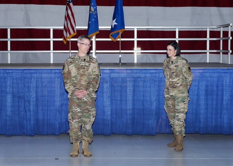 Lt. Gen. Timothy Haugh, 16th Air Force commander, stands in front of a stage with Chief Master Sgt. Summer D. Leifer as they speak to team Offutt members during the 16th Air Force All Call.