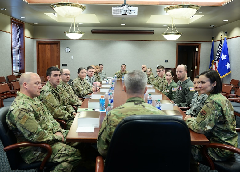 Team Offutt members listens to Lt. Gen. Timothy Haugh, 16th Air Force commander, during a luncheon held inside the 55th Mission Support Group conference room at Offutt Air Force Base, Nebraska.