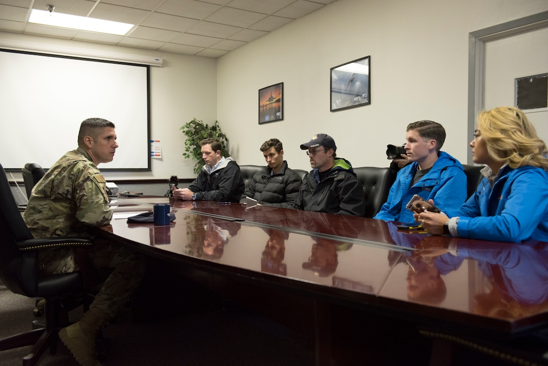 Chief Master Sgt. Thomas Henzl, 92nd Security Forces Squadron security forces manager, greets six members of local Spokane news agencies during a Year of the Defender media day event at Fairchild Air Force Base, Washington, Oct. 29, 2019. YotD is part of a security forces revitalization initiative that aims to update and upgrade combat Airmen units that have been worked hard since the terrorist attacks of 9/11. (U.S. Air Force photo by Senior Airman Ryan Lackey)