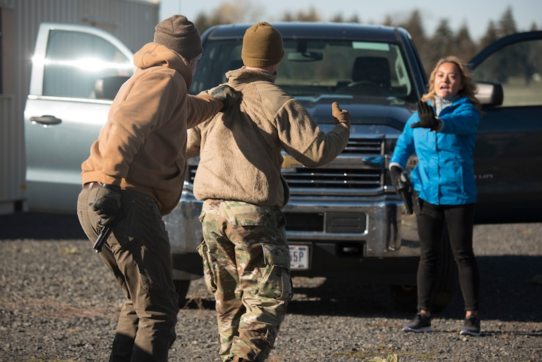 92nd Security Forces Squadron Airmen practice a show of force traffic stop training exercise with Nikki Torres, KXLY reporter, during a Year of the Defender media day event at Fairchild Air Force Base, Washington, Oct. 29, 2019. Show of Force training is vital to help train Defenders on how to think quickly and react with an appropriate amount of force. (U.S. Air Force photo by Senior Airman Ryan Lackey)