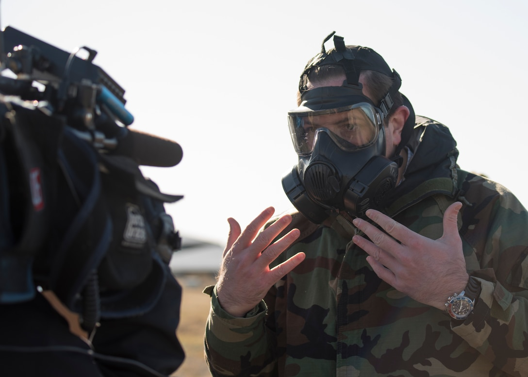 Peter Maxwell, KHQ reporter, experiences what it's like to work in chemical protective gear during a Year of the Defender media day event at Fairchild Air Force Base, Washington, Oct. 29, 2019. Chemical, biological radiological and nuclear (CBRN) gear is a vital to protect Airmen in dangerous environments, but presents a challenge to work in, so CBRN training is a vital component in keeping U.S. forces able to operate in any situation. (U.S. Air Force photo by Senior Airman Ryan Lackey)