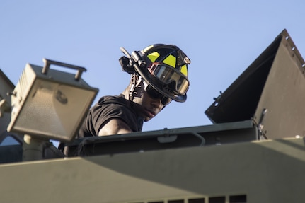 U.S. Army Reserve firefighters cool Autumn flames