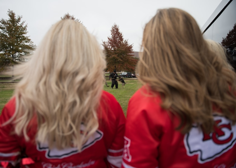 National Football League's Kansas City Chiefs cheerleaders watch a military working dog demonstration by the 509th Security Forces Squadron members.