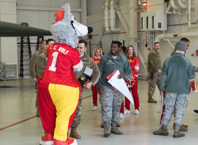 K.C. Wolf, the official mascot of the National Football League's Kansas City Chiefs, meets with Airmen during a B-2 Spirit tour at Whiteman Air Force Base, Missouri, Oct. 29, 2019.