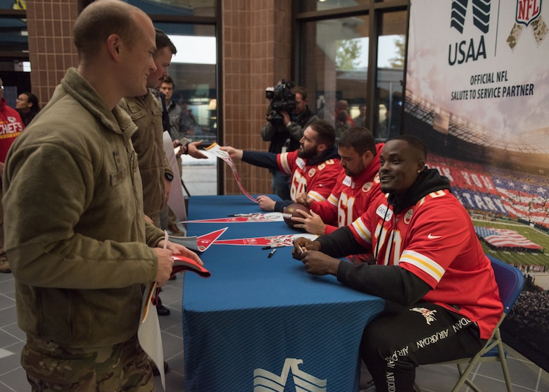National Football League's Kansas City Chiefs offensive linemen meet with fans during a visit at Whiteman Air Force Base, Missouri, Oct. 29, 2019.
