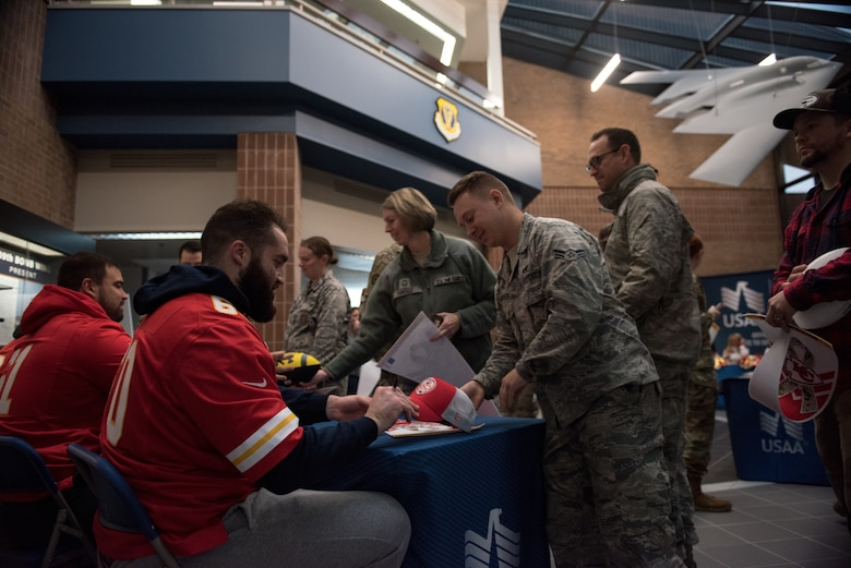National Football League's Kansas City Chiefs offensive linemen meet with fans and sign autographs during a visit at Whiteman Air Force Base, Missouri, Oct. 29, 2019.