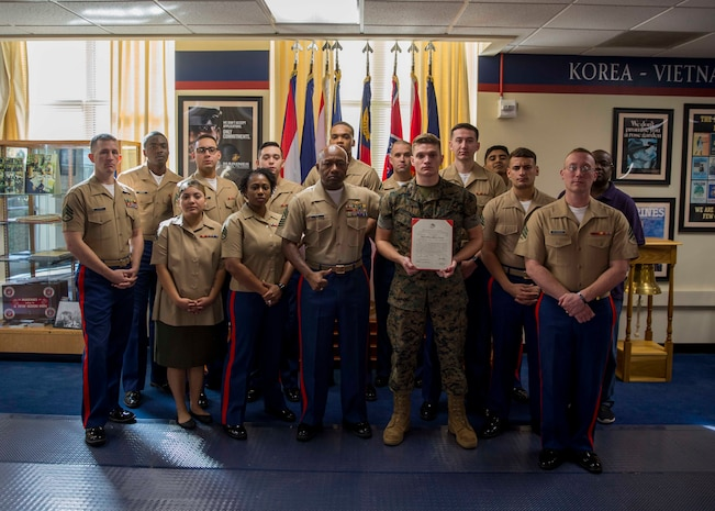 U.S. Marines with 6th Marine Corps District pose for a group photo after the promotion ceremony of LCpl. Devon Hinterlong at the 6MCD Headquarters aboard Marine Corps Recruit Depot Parris Island, South Carolina on Nov. 01, 2019. Hinterlong serves as an administrative specialist. (U.S. Marine Corps photo by Cpl. Jack A. E. Rigsby)