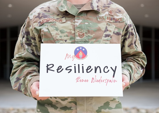 Holding a resiliency sign.