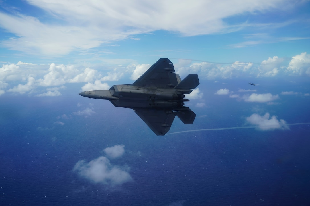 Two F-22 Raptors fly in formation
