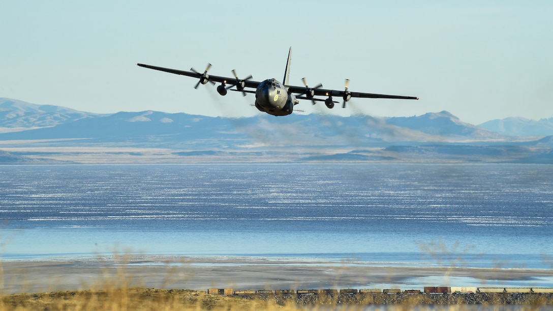 A C-130 Hercules flies during an aerial spray operation.