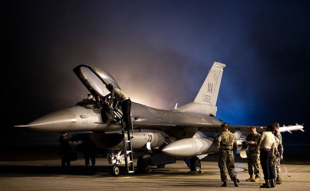 Airmen prepare an F-16 Fighting Falcon for takeoff