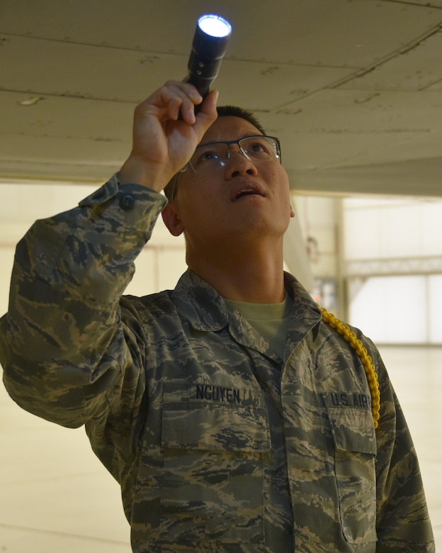 Airman 1st Class Cuong Nguyen, 373rd Training Squadron Detachment 8 Mission Ready Airmen student, practices a pre-flight inspection on the interior of a KC-46A Pegasus Oct. 29, 2019, at McConnell Air Force Base, Kan.