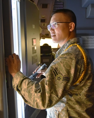 Airman 1st Class Cuong Nguyen, 373rd Training Squadron Detachment 8 Mission Ready Airmen student, practices a pre-flight inspection on the exterior of a KC-46A Pegasus Oct. 29, 2019, at McConnell Air Force Base, Kan.