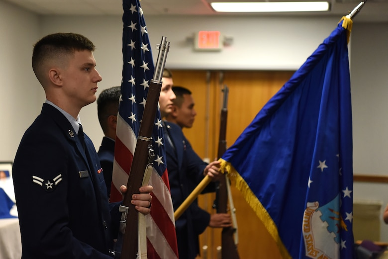 The 81st Contracting Squadron color guard presents the colors during the Sablich Center Auditorium room dedication ceremony for George Budz inside the Sablich Center at Keesler Air Force Base, Mississippi, Oct. 31, 2019. The auditorium has been renamed after Budz who passed away Aug. 3, 2018. Budz served as the 81st CONS commander, the 81st Mission Support Group deputy commander and worked nine years in civil service after he retired as a lieutenant colonel. (U.S. Air Force photo by Senior Airman Suzie Plotnikov)