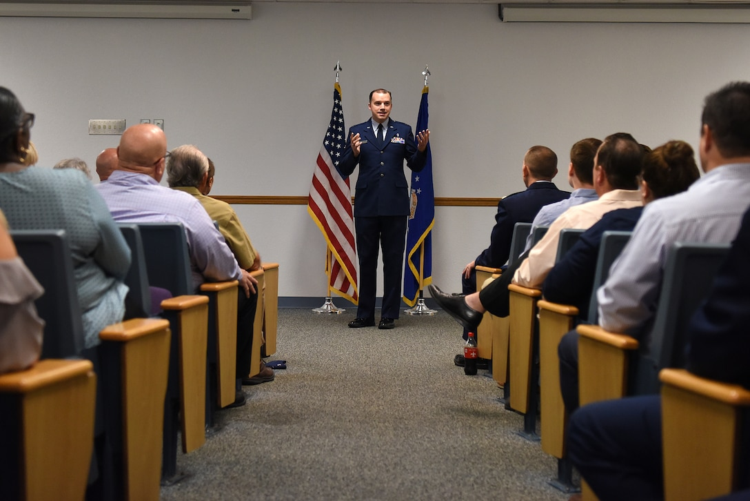 U.S. Air Force Chaplain (Capt.) John Reutemann, 81st Training Wing chaplain, gives remarks during the Sablich Center Auditorium room dedication ceremony for George Budz inside the Sablich Center at Keesler Air Force Base, Mississippi, Oct. 31, 2019. The auditorium has been renamed after Budz who passed away Aug. 3, 2018. Budz served as the 81st Contracting Squadron commander, the 81st Mission Support Group deputy commander and worked nine years in civil service after he retired as a lieutenant colonel. (U.S. Air Force photo by Senior Airman Suzie Plotnikov)