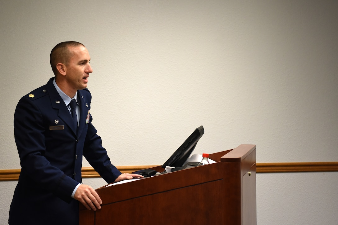 U.S. Air Force Maj. Bruce Hebert, 81st Contracting Squadron commander, gives remarks during the Sablich Center Auditorium room dedication ceremony for George Budz inside the Sablich Center at Keesler Air Force Base, Mississippi, Oct. 31, 2019. The auditorium has been renamed after Budz who passed away Aug. 3, 2018. Budz served as the 81st CONS commander, the 81st Mission Support Group deputy commander and worked nine years in civil service after he retired as a lieutenant colonel. (U.S. Air Force photo by Senior Airman Suzie Plotnikov)