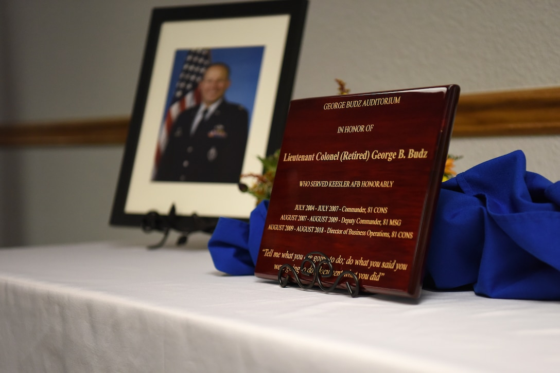 A plaque is displayed during the Sablich Center Auditorium room dedication ceremony for George Budz inside the Sablich Center at Keesler Air Force Base, Mississippi, Oct. 31, 2019. The auditorium has been renamed after Budz who passed away Aug. 3, 2018. Budz served as the 81st Contracting Squadron commander, the 81st Mission Support Group deputy commander and worked nine years in civil service after he retired as a lieutenant colonel. (U.S. Air Force photo by Senior Airman Suzie Plotnikov)