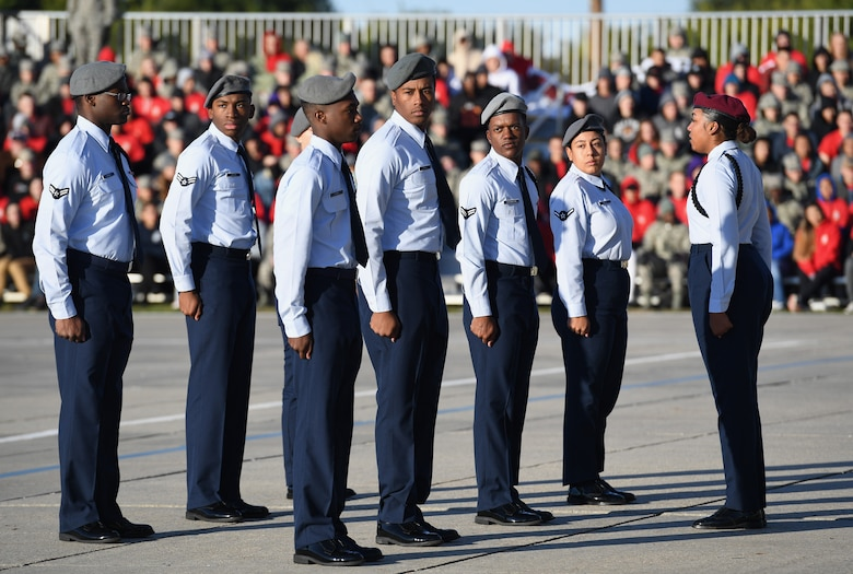 Members of the 335th Training Squadron regulation drill team perform during the 81st Training Group drill down on the Levitow Training Support Facility drill pad at Keesler Air Force Base, Mississippi, Nov. 1, 2019. Airmen from the 81st TRG competed in a quarterly open ranks inspection, regulation drill routine and freestyle drill routine. Keesler trains more than 30,000 students each year. While in training, Airmen are given the opportunity to volunteer to learn and execute drill down routines. (U.S. Air Force photo by Kemberly Groue)