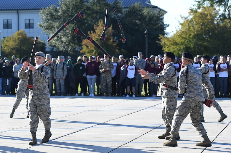 Members of the 335th Training Squadron freestyle drill team perform during the 81st Training Group drill down on the Levitow Training Support Facility drill pad at Keesler Air Force Base, Mississippi, Nov. 1, 2019. Airmen from the 81st TRG competed in a quarterly open ranks inspection, regulation drill routine and freestyle drill routine. Keesler trains more than 30,000 students each year. While in training, Airmen are given the opportunity to volunteer to learn and execute drill down routines. (U.S. Air Force photo by Kemberly Groue)