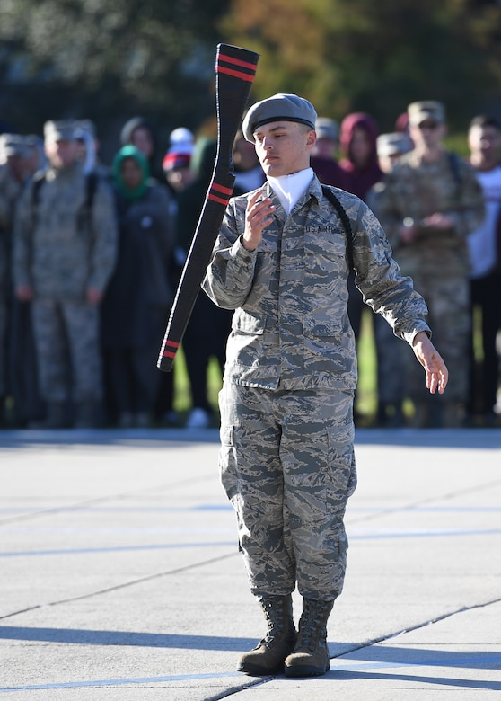 U.S. Air Force Airman 1st Class Ethan Muncy, 335th Training Squadron freestyle drill master, performs during the 81st Training Group drill down on the Levitow Training Support Facility drill pad at Keesler Air Force Base, Mississippi, Nov. 1, 2019. Airmen from the 81st TRG competed in a quarterly open ranks inspection, regulation drill routine and freestyle drill routine. Keesler trains more than 30,000 students each year. While in training, Airmen are given the opportunity to volunteer to learn and execute drill down routines. (U.S. Air Force photo by Kemberly Groue)