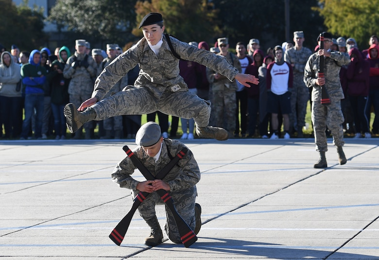 U.S. Air Force Airman Danielle Gaucher and Airman 1st Class Ethan Muncy, 335th Training Squadron freestyle drill team members, perform during the 81st Training Group drill down on the Levitow Training Support Facility drill pad at Keesler Air Force Base, Mississippi, Nov. 1, 2019. Airmen from the 81st TRG competed in a quarterly open ranks inspection, regulation drill routine and freestyle drill routine. Keesler trains more than 30,000 students each year. While in training, Airmen are given the opportunity to volunteer to learn and execute drill down routines. (U.S. Air Force photo by Kemberly Groue)
