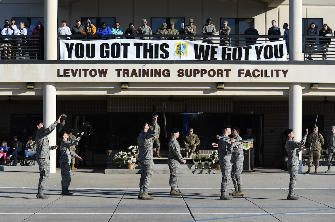 Members of the 338th Training Squadron freestyle drill team perform during the 81st Training Group drill down on the Levitow Training Support Facility drill pad at Keesler Air Force Base, Mississippi, Nov. 1, 2019. Airmen from the 81st TRG competed in a quarterly open ranks inspection, regulation drill routine and freestyle drill routine. Keesler trains more than 30,000 students each year. While in training, Airmen are given the opportunity to volunteer to learn and execute drill down routines. (U.S. Air Force photo by Kemberly Groue)