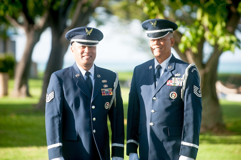 Staff Sgt. Darrell Bactad and Tech. Sgt. Mark Crabbe, 204th Airlift Squadron information managers, gather to practice Honor Guard movements Oct. 4, 2019, at Joint Base Pearl Harbor-Hickam, Hawaii. The two friends have performed military ceremonies side-by-side in the Hawaii Air National Guard Honor Guard team since the early 2000s. Crabbe became an honor guardsmen in 2001 and Bactad joined in 1999, when the unit was established. (U.S. Air National Guard photo by Senior Airman John Linzmeier)