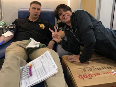 Maj. Charles Wyatt (left), executive officer, 5th Medical Recruiting Battalion, donates blood at a mobile blood drive hosted by the Armed Services Blood Program with Lt. Col. Mary Rivera (right), commander, 5th MRB, at the Jimmy Brought Fitness Center, Joint Base San Antonio-Fort Sam Houston, Texas, Oct. 30.