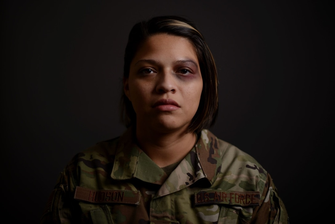 Senior Airman Jessica Hudson, 22nd Air Refueling Wing community support coordinator and violence prevention integrator assistant, displays a faux bruise on her eye Oct. 30, 2019, at McConnell Air Force Base, Kan. The Black Eye Campaign, hosted by McConnell's Violence Prevention team, enabled volunteers to spend the day wearing a black eye in the hopes starting conversations and informing others of the stigmas surrounding domestic violence. The campaign sought to raise awareness and provide available resources for those affected. (U.S. Air Force photo by Airman 1st Class Nilsa E. Garcia)