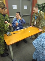 """Junior Enlisted Leadership Forum participants take part in a """"Marshmallow Challenge"""", at the 17 Wing, Winnipeg, Canada Oct. 21 – 25, 2019. The JELF is designed to inform junior Non-Commissioned Officers about professional development strategies to grow them into tomorrow's senior enlisted leaders. (Courtesy photo)"""