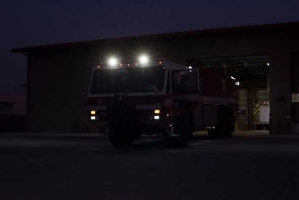 Firefighters assigned to the 60th Civil Engineer Squadron Fire and Emergency Services flight conduct vehicle checks Oct. 29, 2019, at Travis Air Force Base, California. The FES flight provides emergency response support at Travis AFB and across Solano County. (U.S. Air Force photo by Tech. Sgt. James Hodgman)
