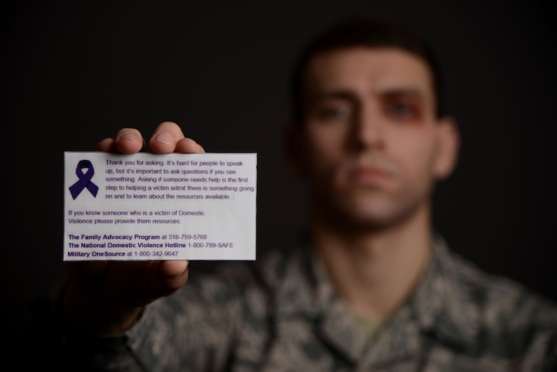 Airman 1st Class Marc Garcia, 22nd Wing Staff Agencies photojournalist, holds up a Violence 