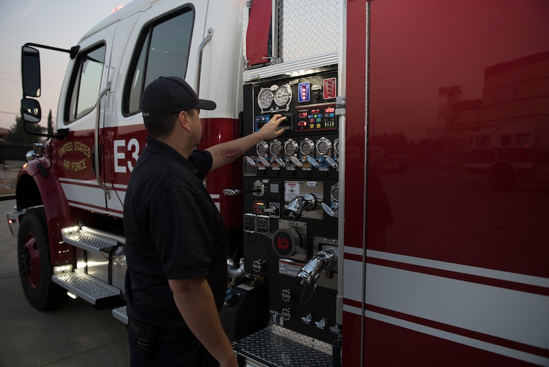 David Silva, 60th Civil Engineer Squadron Fire and Emergency Services flight engineer, conducts a check on equipment outside a firetruck Oct. 29, 2019, at Travis Air Force Base, California. With the start of every shift, the FES flight conducts inspections on more than 1,000 items including vehicles, protective equipment and hardware. (U.S. Air Force photo by Tech. Sgt. James Hodgman)