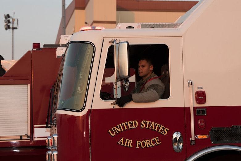 Senior Airman Juner Tenorio, 60th Civil Engineer Squadron Fire and Emergency Services flight driver operator, performs an operational check on a firetruck Oct. 29, 2019, at Travis Air Force Base, California. With the start of every shift, the FES flight conducts inspections on more than 1,000 items including vehicles, protective equipment and hardware.  (U.S. Air Force photo by Tech. Sgt. James Hodgman)