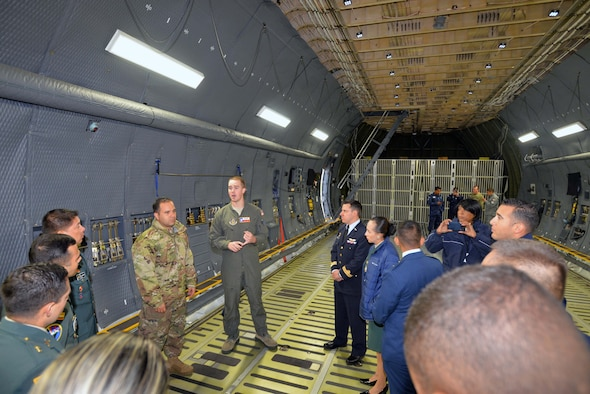 Tech. Sgt. Joshua Green, 356th Airlift Squadron loadmaster, describes the 433rd Airlift Wing's C-5M Super Galaxy's cargo carrying capabilities to Inter-American Air Forces Academy students Oct. 30, 2019 at Joint Base San Antonio-Lackland.