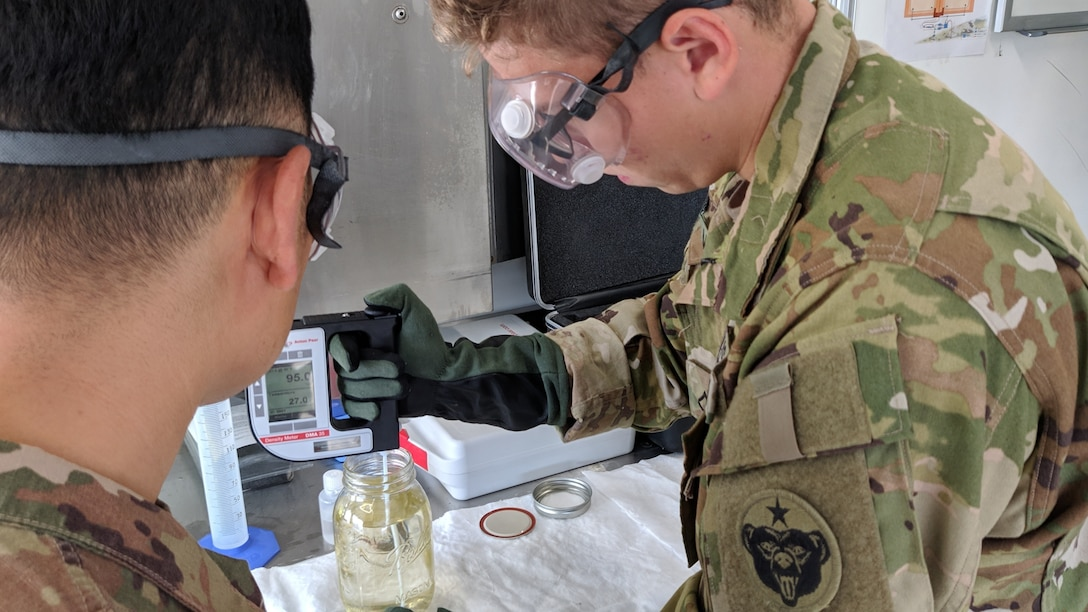 Pfc. Stefan Moreno, petroleum supply specialist, 574th Composite Suppy Company, performs an American Petroleum Institute (API) gravity test on a batch of fuel at Erbil, Iraq, Oct. 16, 2019. The API gravity test measures how heavy or light petroleum is compared to water, which is used to compare densities of petroleum liquids.