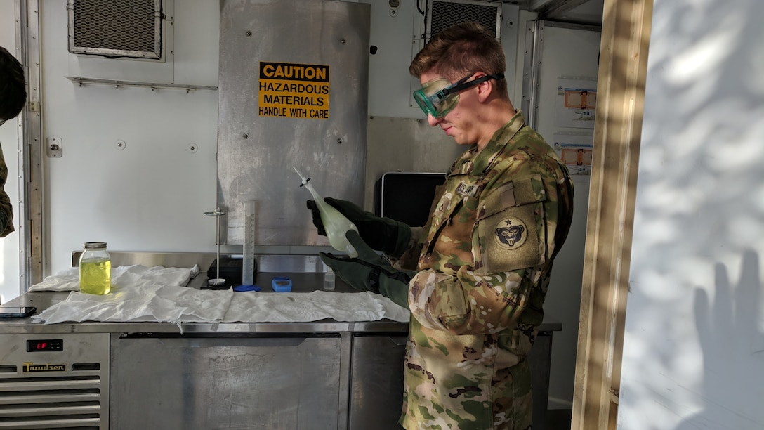 Pfc. Stefan Moreno, petroleum supply specialist, 574th Composite Supply Company, conducts a visual sight test on a batch of fuel at Erbil, Iraq, Oct. 16, 2019. Moreno is making sure the fuel is clear of debris by checking for contaminants and discoloration.
